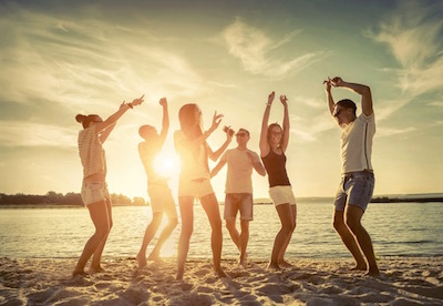 party-on-beach-at-sunset