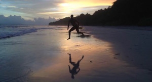 man-jumps-on-beach